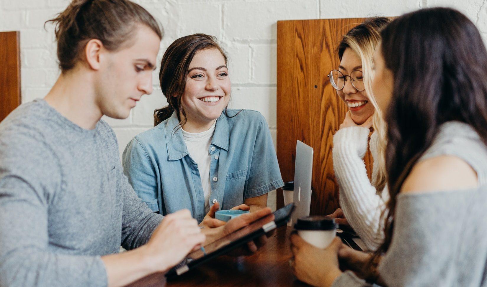 happy people talking in a coffee shop